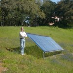 """image of Bill Shady standing next to a solar panel"""